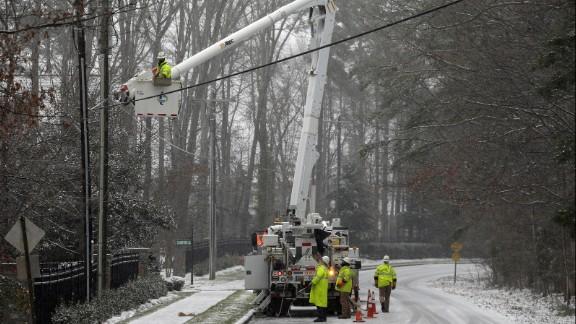 Duke Energy employees work to restore power in Matthews, North Carolina, on January 22.