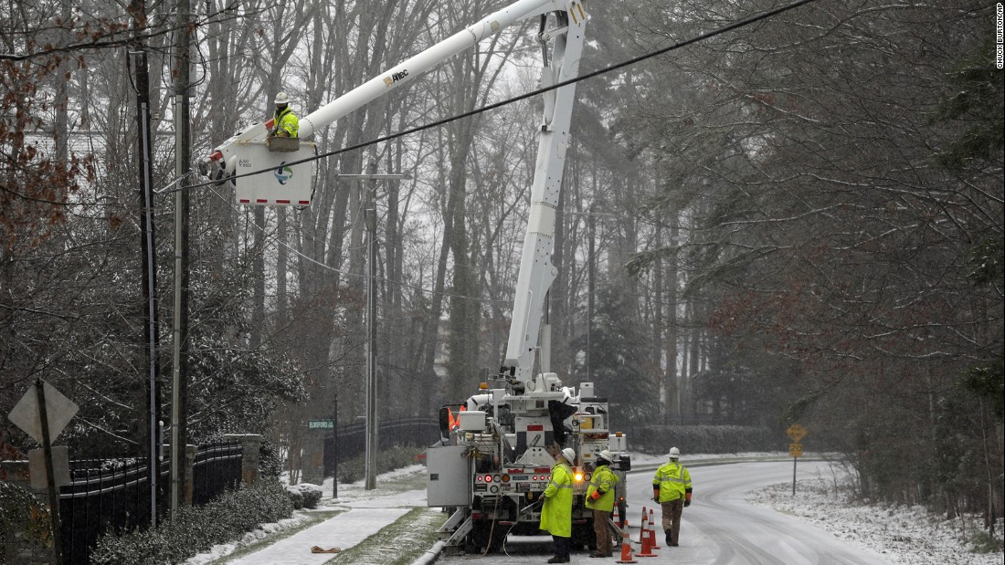 Duke Energy employees work to restore power in Matthews, North Carolina, on January 22.