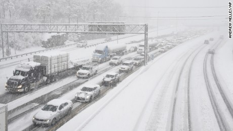 Snow slows down traffic on Interstate 40, Friday morning, Jan. 22, 2016, in Nashville, Tenn. A blizzard menacing the Eastern United States started dumping snow in Virginia, Tennessee and other parts of the South on Friday as millions of people in the storm's path prepared for icy roads, possible power outages and other treacherous conditions. (Andrew Nelles/The Tennessean via AP)