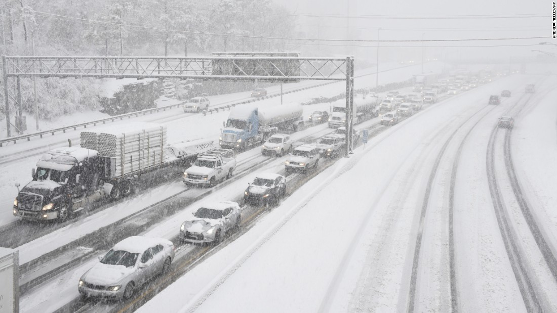Snow slows down traffic on Interstate 40 in Nashville on Friday, January 22.