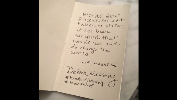 """Actress Debra Messing copies an inspiring quote on the written word from """"Life"""" magazine."""