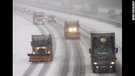 Snow plows and traffic make their way north along Interstate 95 as snow begins to fall in Ashland, Va., Friday, Jan. 22, 2016. Portions of Virginia are under a blizzard warning. (AP Photo/Steve Helber)