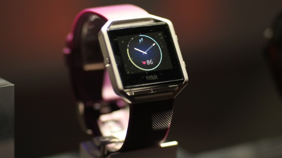 "The new FitBit Blaze is seen at a press conference on CES Press Day, January 5, 2016 in Las Vegas, Nevada ahead of the CES 2016 Consumer Electronics Show. Fitbit on January 5unveiled its ""smart fitness watch,"" aiming to get into the growing smartwatch segment with upgraded fitness tracking features. The company, which leads the wearable tech market with its wrist-worn trackers but is being challenged by the rise of smartwatches from Apple and others, said its $199 Fitbit Blaze watch was available for pre-order and would be in retail stores globally in May. AFP PHOTO / DAVID MCNEW / AFP / DAVID MCNEW        (Photo credit should read DAVID MCNEW/AFP/Getty Images)"