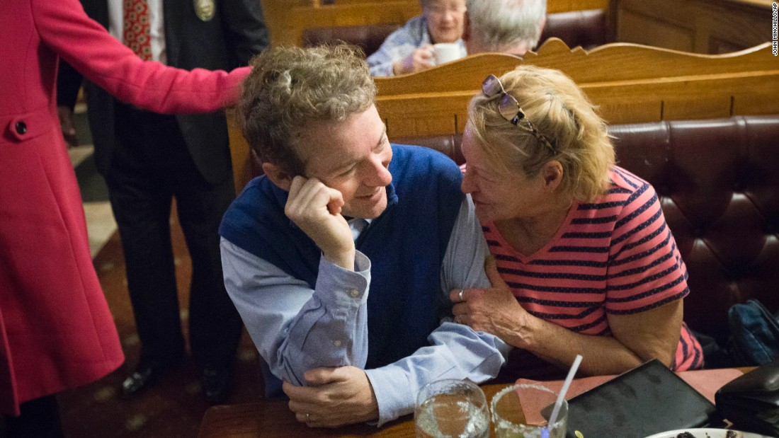 A woman hugs the arm of U.S. Sen. Rand Paul as the Republican presidential candidate makes a campaign stop at a restaurant in Manchester, New Hampshire, on Friday, January 22.