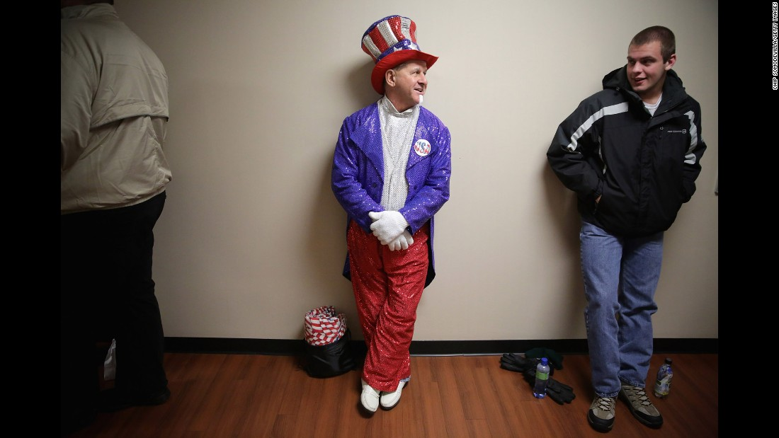 A man in a homemade Uncle Sam outfit waits in line to see presidential candidate Donald Trump in Lynchburg, Virginia, on Monday, January 18.