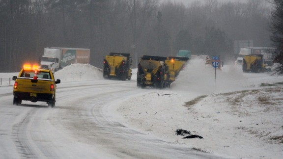 A snow plows clear the roadway along Interstate 40 during a winter storm on January 22, 2016 in Chapel Hill, North Carolina. A major snowstorm is forecast for the East Coast this weekend with some areas getting a possible one to two feet of snow. (Photo by Lance King/Getty Images)