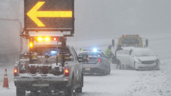 An accident victim near Richmond removes belongings from a car along Interstate 95 on January 22.