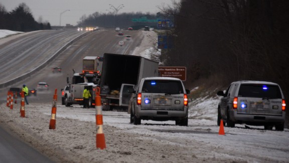 North Carolina state troopers respond to an accident involving a tractor-trailer in Whitsett, North Carolina, on January 22.