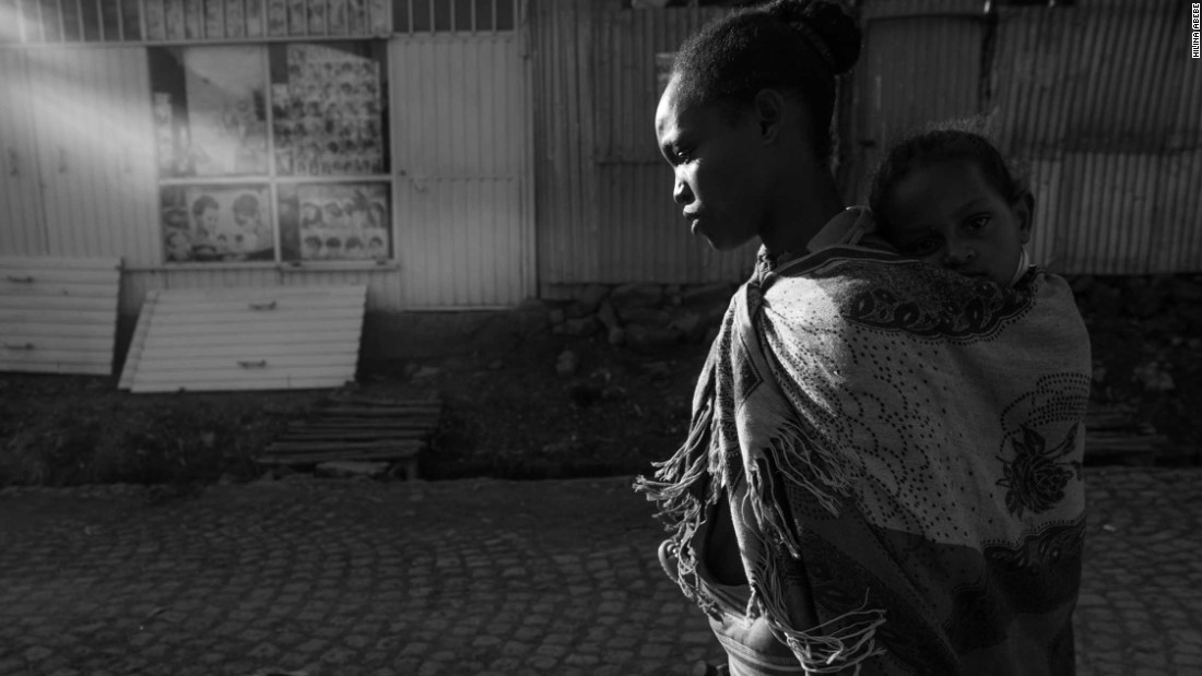 After a day for work, Meseret walks back to her home with Meron on her back.