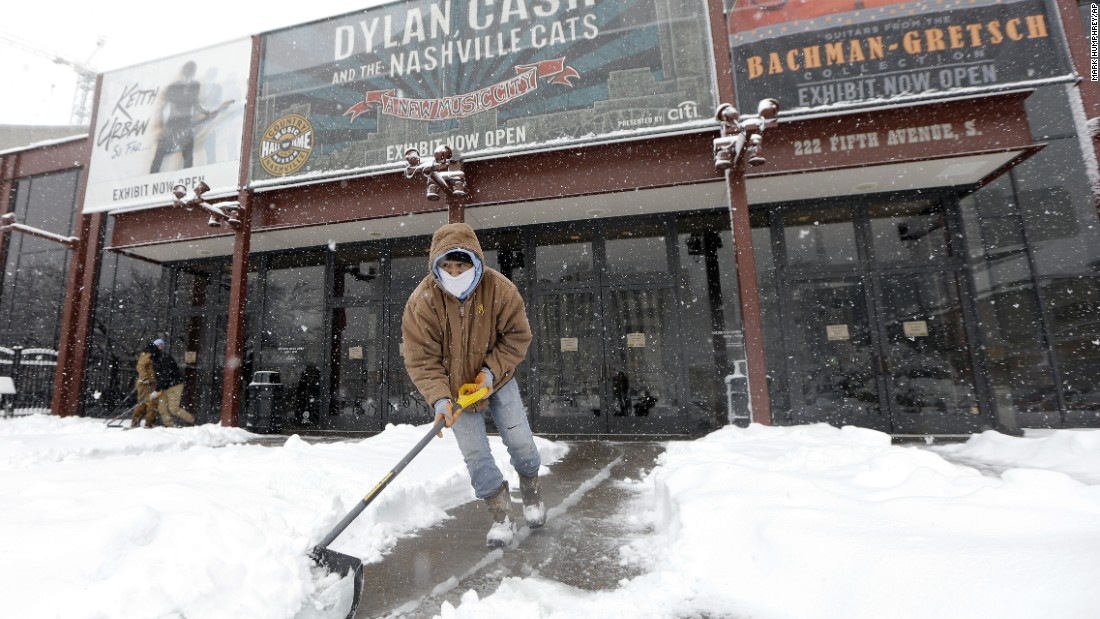 Snow is shoveled outside the entrance of the Country Music Hall of Fame in Nashville, Tennessee, on January 22.