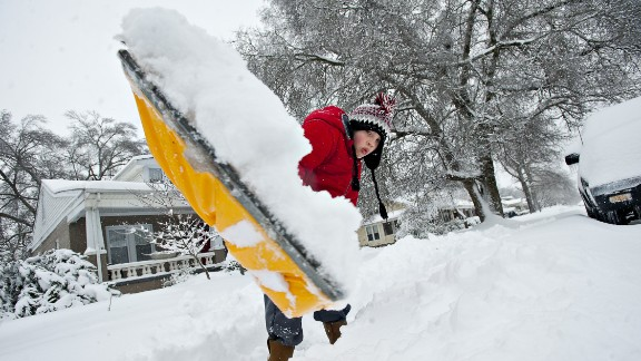 A 9-year-old boy shovels the sidewalk at his house in Bowling Green, Kentucky, on January 22.