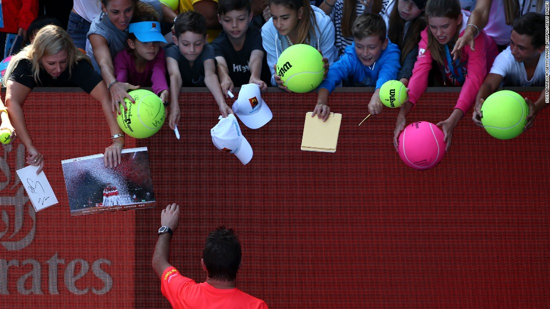 Wawrinka signs autographs after the match. The win was the 400th of his career.