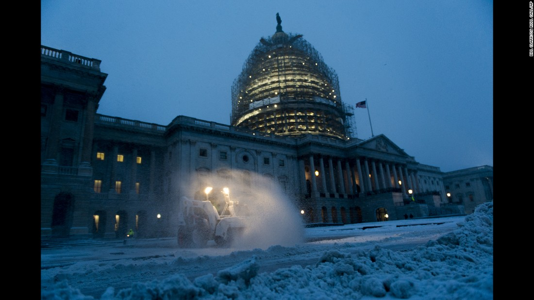 Crews clear the East Plaza at the U.S. Capitol as they try to keep up with the heavy snow in Washington on Friday, January 22.