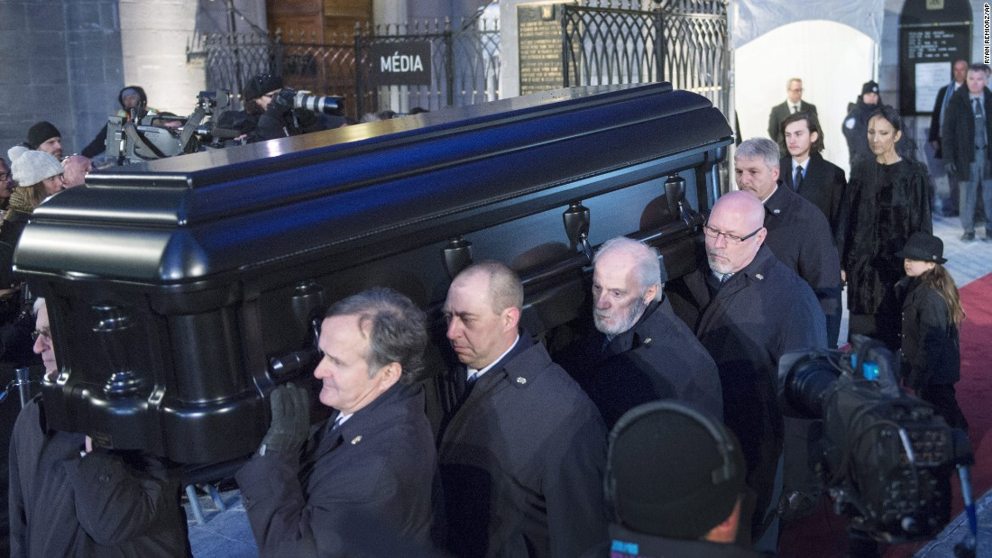 Dion walks behind her husband's casket following the funeral services. The family will host a public memorial for fans in Las Vegas on February 3, at Caesars Palace Colosseum.