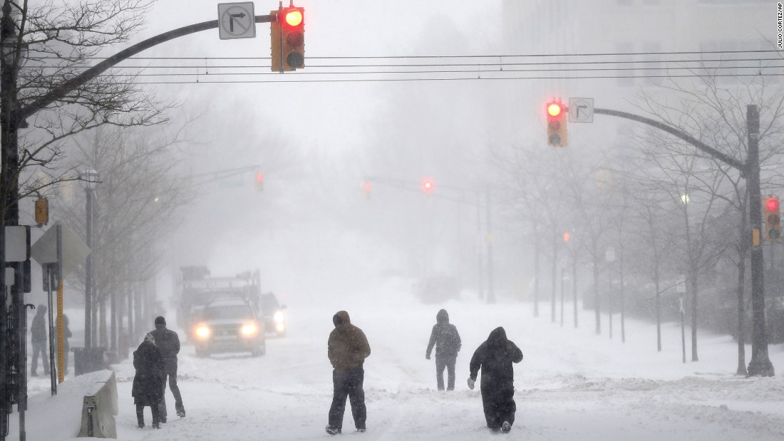 People make their way down a street in Jersey City, New Jersey, on January 23.