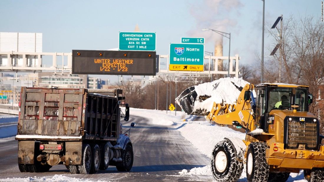 Crews work to remove the snow from a highway in Washington on January 24.
