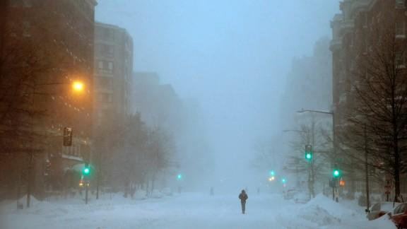 A pedestrian in Washington walks south on 13th Street on Saturday, January 23.