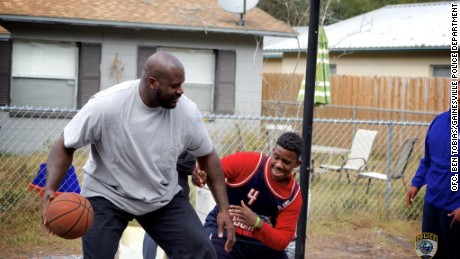 Shaquille O'Neal joined officers from the Gainesville Police department in game of basketball with againsth a group of neighborhood kids.