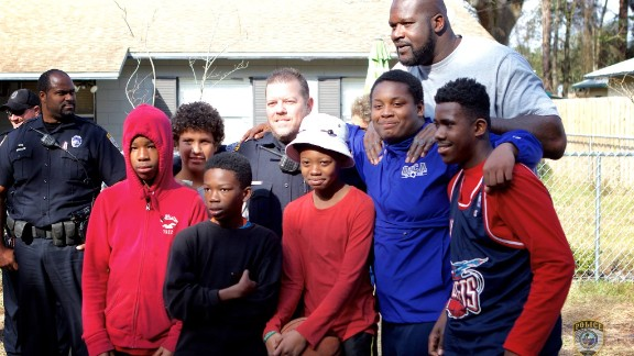 Shaquille O'Neal poses with a group of neighborhood kids in Gainesville, Florida.