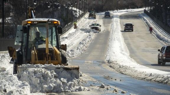 Crews clear a bridge in Lynchburg, Virginia, on January 24.