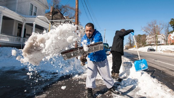 Quan Hill, left, and Lamont Hobson shovel their driveway in Lynchburg on January 24.