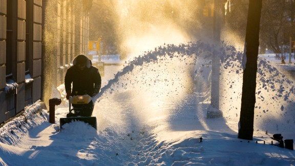 Snow is cleared along a street in the Upper West Side neighborhood of New York on January 24.