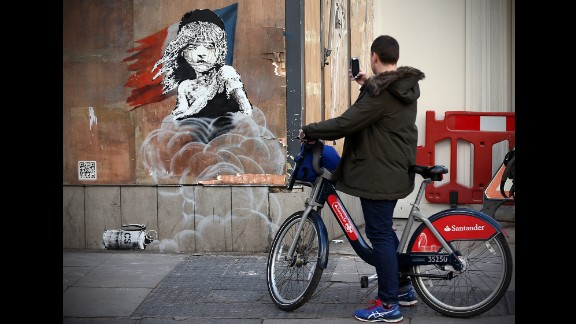 On January 25, a new mural by street artist Banksy appeared on the French Embassy in London, criticising the French authorities' reported use of teargas in a refugee camp in Calais, France. A riff on the iconic Les Misérables poster, it shows a young girl enveloped by CS gas, crying.