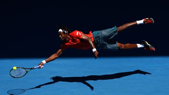 "Gael Monfils was at his spectacular best during his four-set victory over Russian Andrey Kuznetsov. The Frenchman injured his hand diving for a shot and told reporters: ""I'm lucky to not have a fracture."""