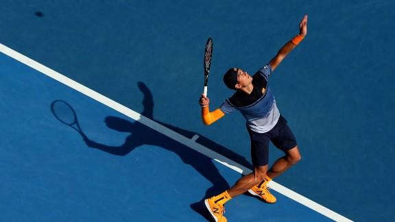 Milos Raonic upset 2014 champion Stan Wawrinka 6-4 6-3 5-7 4-6 6-3 on Monday to reach the Australian Open quarterfinals.