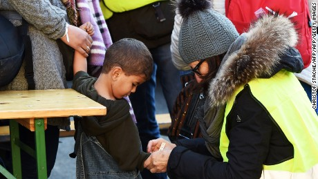 Migrants are issued wristbands after arriving at the Austrian-German border in October.