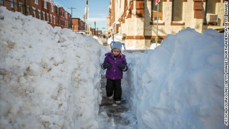 PHILADELPHIA, PENNSYLVANIA  - JANUARY 24:  Beatrice Evangeline, 3,  walks through a narrow shoveled path on January 24, 2016  in Philadelphia, Pennsylvania. Millions of people are digging themselves out after a record snow storm affected most of the Mid Atlantic States. (Photo by Jessica Kourkounis/Getty Images)