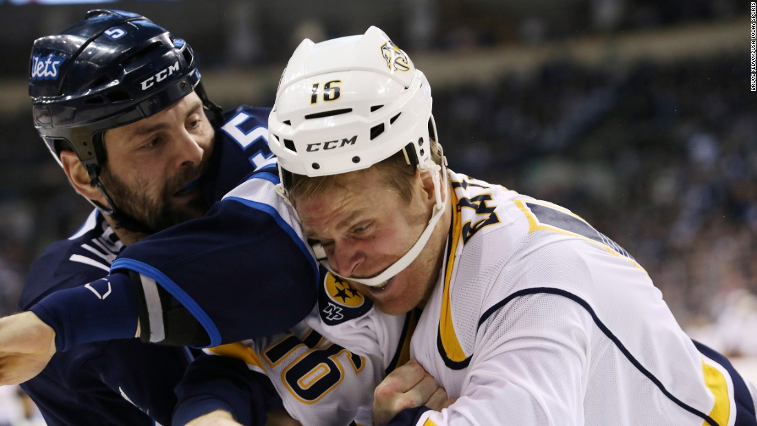 Winnipeg's Mark Stuart, left, fights Nashville's Cody Bass during an NHL game in Winnipeg, Manitoba, on Thursday, January 21.
