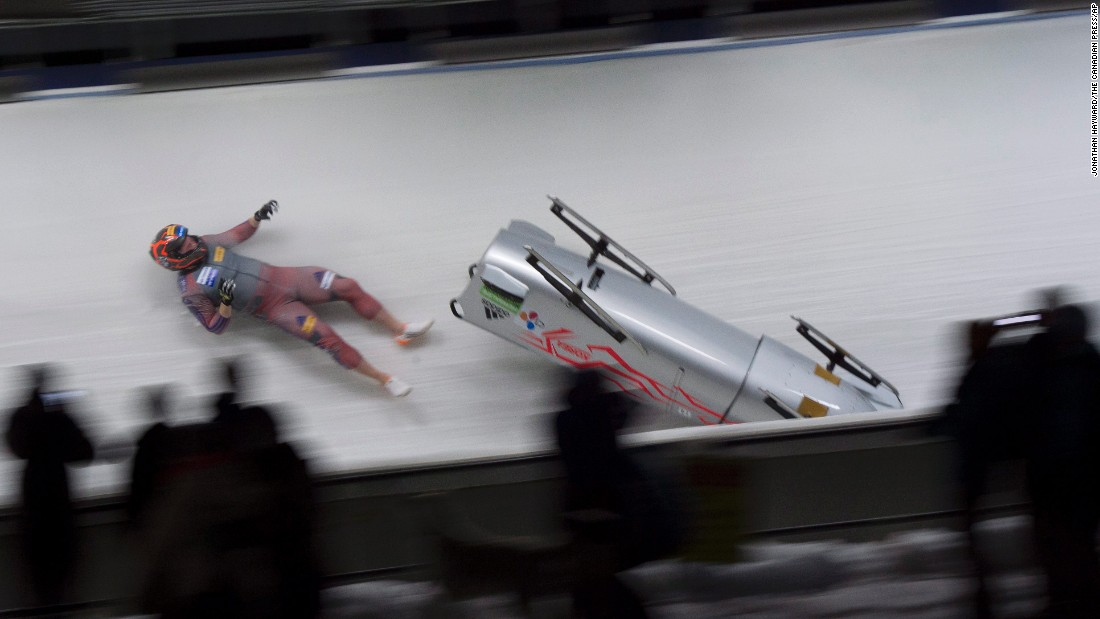 South Korea's Kim Keun-bo falls out of his bobsled during a World Cup crash in Whistler, British Columbia, on Saturday, January 23.