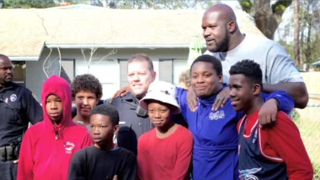 shaquille o'neil shoots hoops with kids intv_00042207