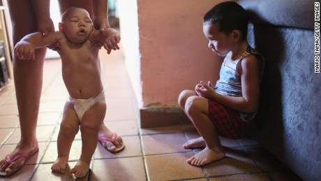 RECIFE, BRAZIL - JANUARY 25: David Henrique Ferreira (L), 5 months, who has microcephaly, is watched by his brother Richard Miguel on January 25, 2016 in Recife, Brazil. In the last four months, authorities have recorded close to 4,000 cases in Brazil in which the mosquito-borne Zika virus may have led to microcephaly in infants. Microcephaly results in newborns with abnormally small heads and is associated with various disorders including decreased brain development. According to the World Health Organization (WHO), the Zika virus outbreak is likely to further spread in South, Central and North America. At least twelve cases of Zika in the United States have now been confirmed by the CDC.  (Photo by Mario Tama/Getty Images)