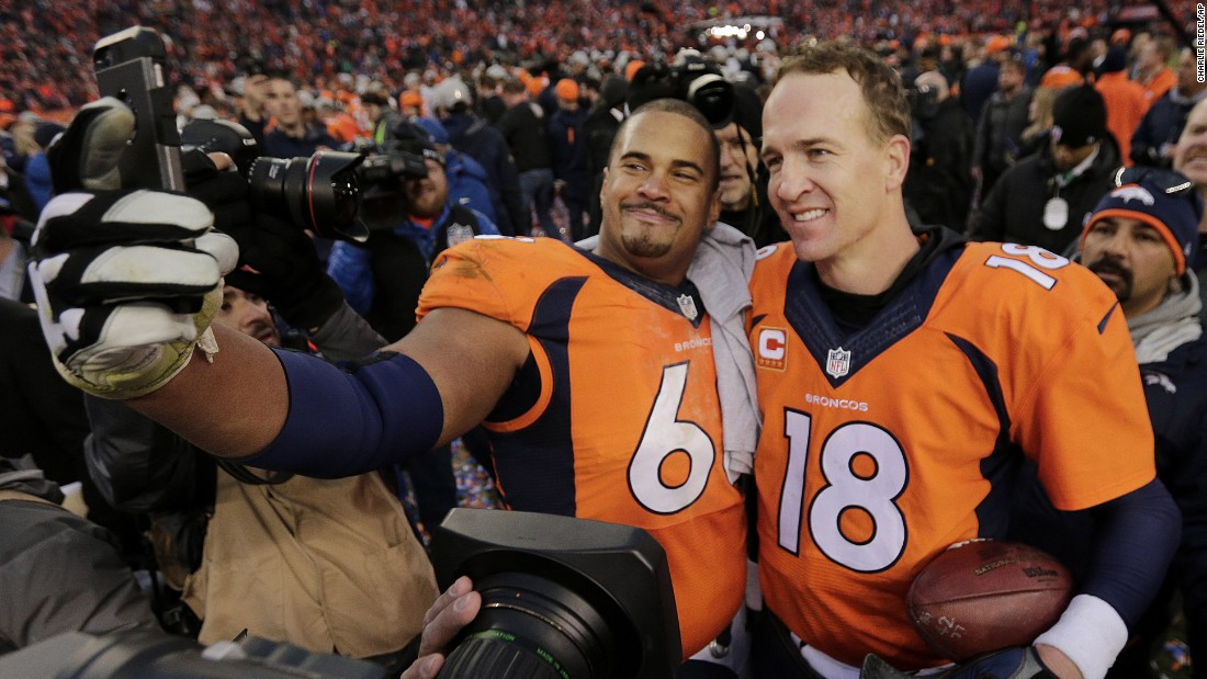 Denver Broncos offensive lineman Ryan Harris takes a selfie with quarterback Peyton Manning after the Broncos won the AFC Championship on Sunday, January 24. They will be playing Newton's Panthers in the Super Bowl.