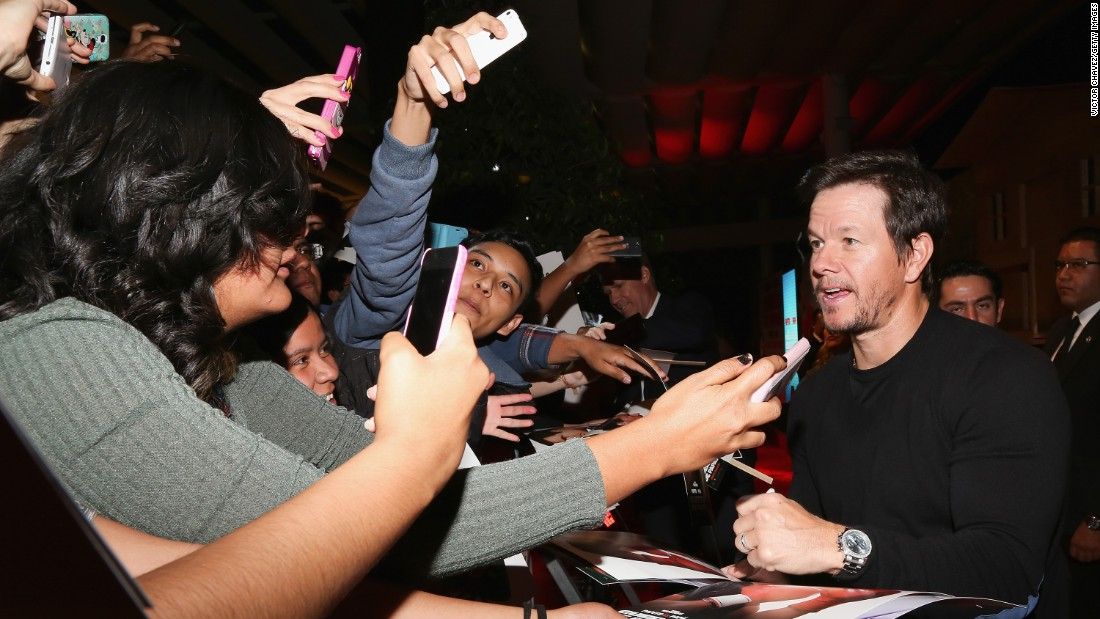 "Actor Mark Wahlberg signs autographs and takes selfies with fans during the ""Daddy's Home"" premiere in Mexico City on Monday, January 25."