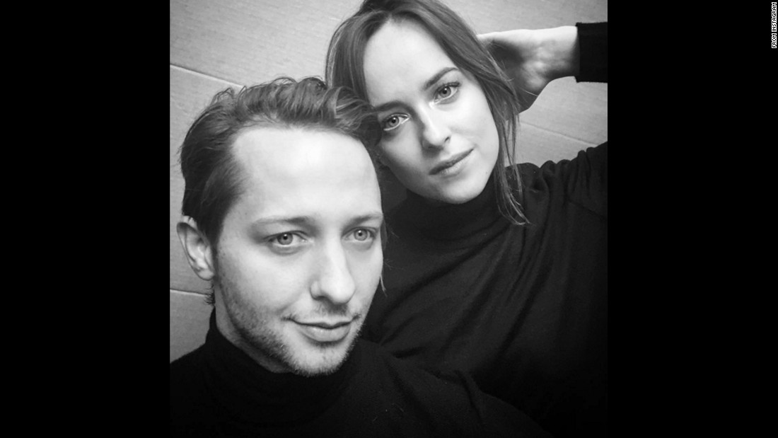 "Vanity Fair writer Derek Blasberg poses with actress Dakota Johnson on Wednesday, January 20. ""If you Google 'Simon Garfunkel Bookends album cover' you'll be super impressed with both mine and@dakotajohnson's music tastes and also our impressions,"" <a href=""https://www.instagram.com/p/BAxd8EhjnOj/"" target=""_blank"">Blasberg said on Instagram.</a>"