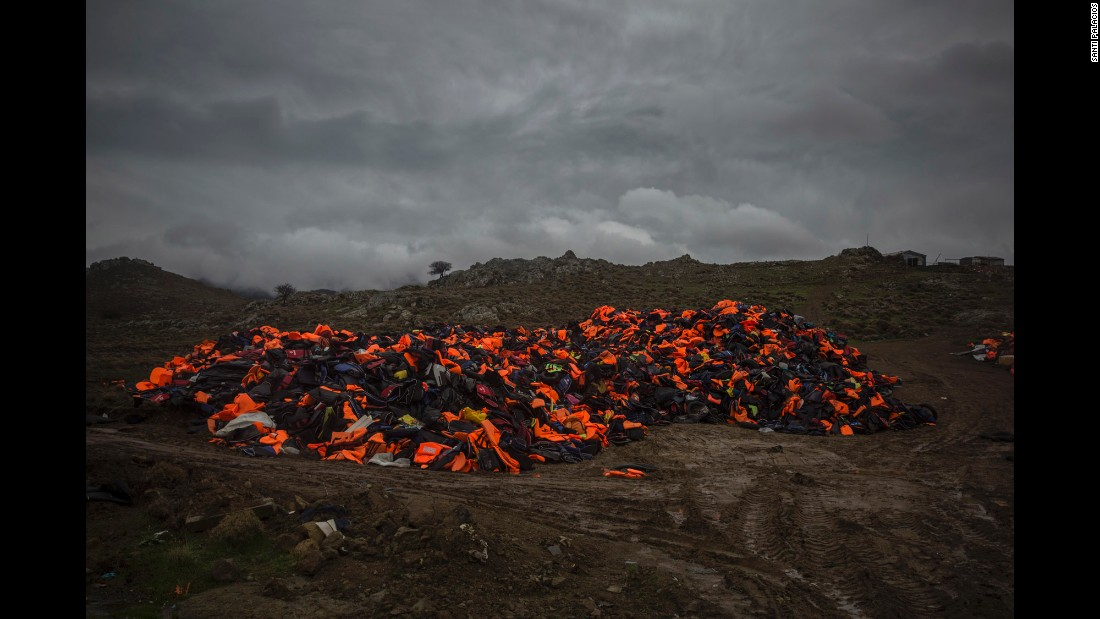 Piles of life jackets used by refugees and migrants to cross the Aegean Sea from the Turkish coast remain stacked on the shore of Lesbos on Thursday, January 7.