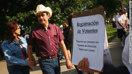 DENVER - SEPTEMBER 14:  Democratic Party workers try to register new voters at a celebration marking Mexican Independence Day September 14, 2008 in Denver, Colorado. Voto Latino is working to register 1 million Latino voters by the 2020 election.  (Photo by John Moore/Getty Images)
