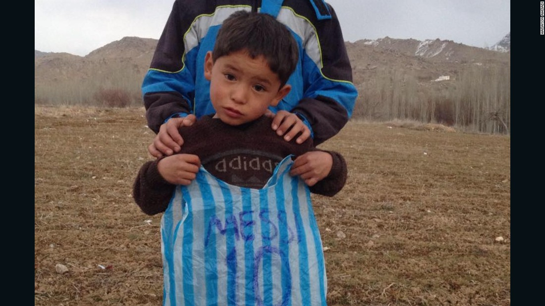 "Murtaza holds the plastic bag that made him famous. His father,  Muhammad Arif Ahmadi, told CNN the five-year-old's brother made it for him when he wouldn't stop crying. ""I told him that we were living in a poor village far from the city and it was impossible for me to get him the shirt,"" he said."