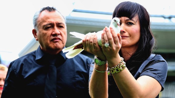 Lomu's widow Nadene releases a dove at New Zealand's home of rugby, Eden Park, during a memorial service in Auckland on November 30, 2015.