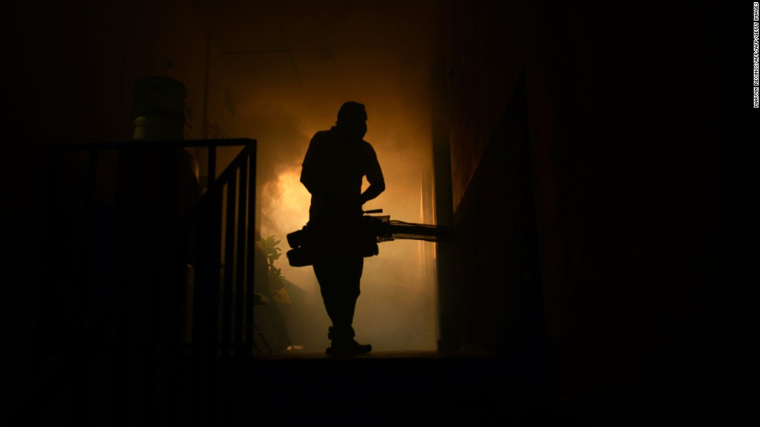 A health ministry employee fumigates a home in Soyapango, El Salvador, on January 27.