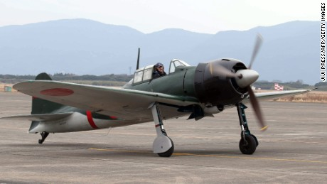A restored World War II-era Mitsubishi A6M Zero fighter taxis on the tarmac at Japan's Maritime Defence Force's Kanoya air base in Kanoya, Japan, on Wednesday, January 27.