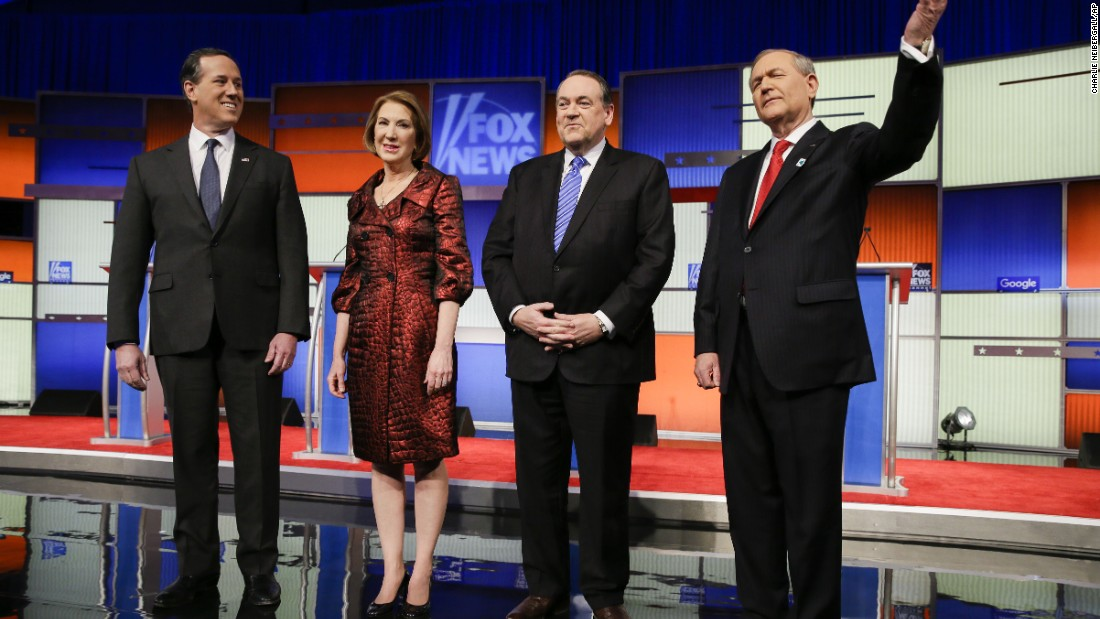 Republican presidential candidates, from left, former Pennsylvania Sen. Rick Santorum, businesswoman Carly Fiorina, former Arkansas Gov. Mike Huckabee and former Virginia Gov. Jim Gilmore greet the audience before a Republican presidential primary debate.
