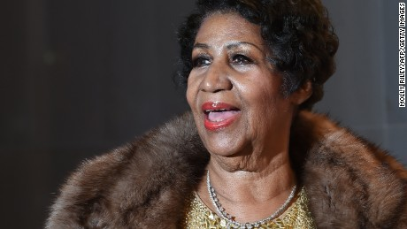 Aretha Franklin poses on the red carpet before the 38th Annual Kennedy Center Honors on December 6, 2015, in Washington, DC. (Photo credit: MOLLY RILEY/AFP/Getty Images)