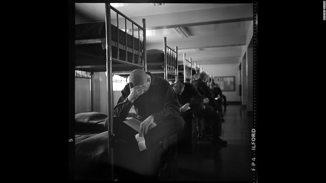 Marine recruits read in their bunks on set.