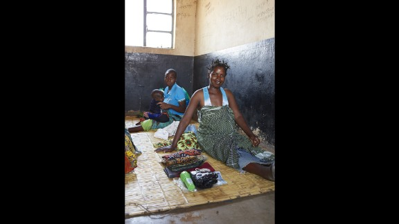 Ellen Phiri, 23, of Malawi, was photographed as she prepared to give birth at the Simulemba Health Centre. It has no clean running water, no sterilization equipment and four toilets for 400 people, according to WaterAid. Water is collected from a water pump shared with the community.