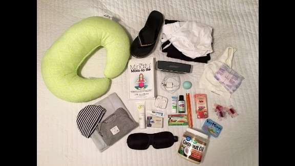 Deanna Neiers maternity bag includes: Music player, coconut oil for massage, lavender oil, arnica gel, snacks, nursing bra and pads, nursing pillow, comfortable clothes to wear at the hospital and on her return home, soft swaddle blanket for the baby, clothes for the baby and a hat for the baby.