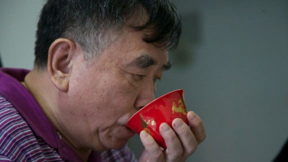 Li drinks tea in his small apartment where he and his wife live on a small monthly pension of around USD$1,200. Since retiring from a state-owned factory, Li works on freelance commissions from his home workshop
